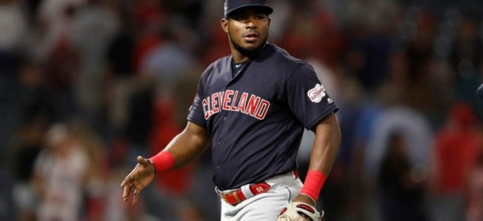 Who will sign first, Yasiel Puig or Brock Holt?